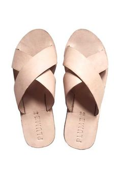 These beautifully crafted sandals are made of sturdy naturally dyed leather. They comfortably mold to your feet while keeping their form -- no pinching or discomfort!  Handmade in Kenya, Malindi Coast.