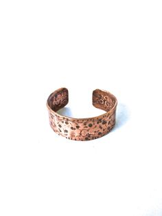 This beautiful copper cuff is hammered and oxidized to a nice finish. It measures 6in long x 1in wide and is slightly adjustable.   Made to order items are one of a kind.