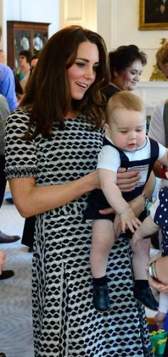 Kate Middleton in a black and white geometric print dress by Tory Burch, and Prince George in New Zealand