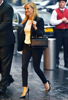 Leggy lady: The 38-year-old displayed her lithe body in slim-fitting black pants, adding some much-needed height to her petite frame with a pair of pointy black stilettos
