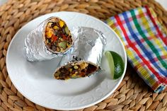 Black Bean And Quinoa Freezer Burritos Recipe Main Dishes, Lunch with canola oil, yellow onion, garlic, jalapeno chilies, red bell pepper, zucchini, corn kernels, tomatoes, cooked quinoa, black beans, ground cumin, hot smoked paprika, chile powder, salt, cilantro, cheese, whole wheat tortillas