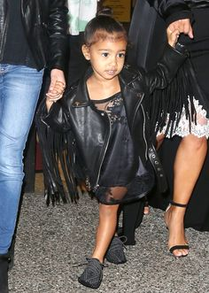 North West in a cute leather jacket and a top knot!