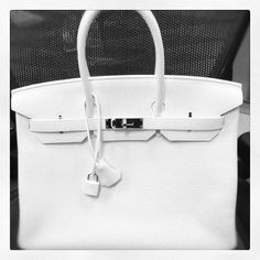 """The white """"Clemence"""" Birkin.  (It's called a """"dream"""" closet for a reason!)...I so want one!! <3"""