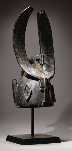 Africa | 'Noo' helmet mask from the Senufo people of the Ivory Coast | Wood; aged blackened patina | ca. 1970s