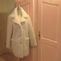 NWT TOPSHOP cream faux furry peacoat. Brand new Topshop, hip furry cream coat with cream lining and cream buttons.  Statement coat!  Beautiful cream color. Unique nubby faux fur material.  Cozy and comfy with satin creamy lining and cream buttons. Extra button included.  Must have coat! Topshop Jackets & Coats Pea Coats