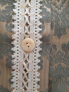 vintage ribbon lace on back of cushion