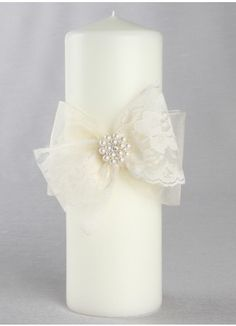 Intricate scalloped lace bows with a pretty pearl and rhinestone pin give this pillar candle an antique, yet whimsical feel. Available in white or ivory. Wedding Unity Candles, Diy Candles, Pillar Candles, Candle Craft, Candle Set, Baptism Candle, Flower Girl Basket, Christmas Candles, Flower Arrangements
