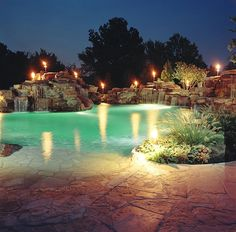Freeform beach-entry pool with fire features and rock waterfalls, Atlantis Pools and Spas Amazing Swimming Pools, Cool Pools, Awesome Pools, Spas, Atlantis Pools, Beach Entry Pool, Beautiful Pools, Beautiful Gardens, Pool Picture