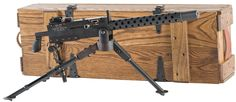 "Manufactured in the 1980s by Tippmann Arms of Fort Wayne, Indiana, this is a finely made copy of the 1919 Browning 30 Caliber Machine Gun, scaled down to match the 22 Long Rifle cartridge and configured for semi-automatic fire only. Overall length is 19 inches, with a blade front sight and folding adjustable rear sight on the receiver, air-cooled barrel with ventilated head shield, and a checkered pistol grip. The right side of the receiver is marked ""MOD. 1919/NO. 230/TIPPMANN ARMS CO./FT…"