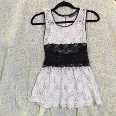 All lace tank All lace black and white tank. This lace is completely see through. It has a gold zipper in the back. This item has been worn a few times. If you have any questions please do not hesitate to ask.⭐️ Tops