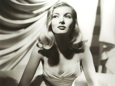 Every 1950's movie star had their own glamorous trademark hair and lipstick, but a porcelain complexion was standard. Veronica Lake was well-known for her stunning 'peek-a-boo' hairstyle.
