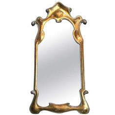Carved Gilt Wooden Mirror | From a unique collection of antique and modern wall mirrors at http://www.1stdibs.com/furniture/mirrors/wall-mirrors/