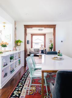 The mint green chairs are from Target and the velvet dining chairs are Anthropologie.