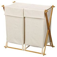 Keep your laundry room tidy and cleaning essentials close at hand with this organizational necessity.Product:  Laundry hamper Construction Material: Wood and cotton    Color: Natural�    Features: Collapsible frame for easy storageTwo removable bags with fabric lids    Dimensions: 30 H x 30 W x 17 D        Shipping: This item ships small parcelExpected Arrival Date: Between 04/17/2013 and 04/25/2013Return Policy: This item is final sale and cannot be returned