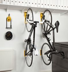 Cycloc Endo Bike Storage.  bike storage system that gets your bike up and out of the way and features wide wheel pads to protect your walls. It holds bikes up to 39lbs. and folds flat when not in use. The Endo design won a 2014 award at Eurobike.