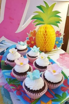 Feast your eyes on this impressive flamingo birthday party! The tropical cupcakes are amazing!See more party ideas and share yours at CatchMyParty.com #catchmyparty #partyideas #flamingos #flamingoparty #girlbirthdayparty #luau #tropicalparty #cupcakes