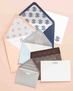 Add a personal touch to envelope interiors using paper patterned with a favorite motif or modern monogram print. Our printable template makes it easy to cut liners that fit well with your wedding stationery suite.