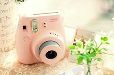 Poloroid camera! So fascinated. Top of my want list!