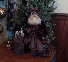 Primitive Old Style Santa on log pile~bells~Christmas tree~Santa bag