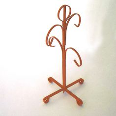 vintage 60'S tall orange iron coffee mug rack - super jewelry hanger for today's use. $12.00, via Etsy.