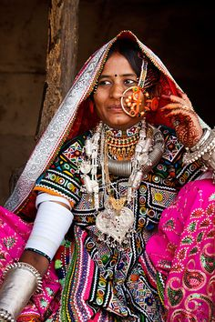 India |  Portrait of a woman from the Marwada Meghwal Harijan tribe wearing traditional clothing and a large golden wedding ring through her nose in the village of Hodka, located roughly 60km from Bhuj in the Kutch District. | © Kimberley Coole