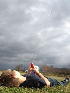 This is shot I took with my Iphone on afternoon recently on our farm. Caleb is flying his kite and enjoying life. Oh to be a kid again. rimshotcreative