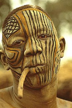 A Nuba of Kau, Sudan, with his unusual mask. Photo by Leni Riefenstahl, 1970's.