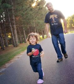 The Apple doesnt fall far from the tree. Both on Navy. Great for new Dads. Father's Day gift New Dad Tee Shirt