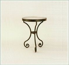 "10016  FORGED IRON TABLE SHOWN WITH OPTIONAL INSET BEVELED GLASS TOP FINISH SHOWN: PUEBLO BASE DIMENSIONS SHOWN DIA 18"" HT 24"""