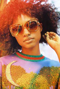 Gabrielle Richardson, 21, in a Gucci printed sweatshirt and square-framed rhinestone sunglasses.