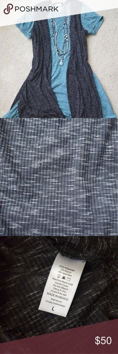 Lularoe Large Joy Beautiful black and white heathered Joy! I am so sad because it is mislabeled - the neck says medium but the side says large. I think it fits like a large because I wear a medium and it's too big for me (I tried because I love the color and it's way too big) :( Washed/worn per llr standards. No issues besides the mismarked size! Is soft with stretch! LuLaRoe Jackets & Coats Vests