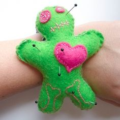 Super cute little voodoo doll pin cushion for my wrist.