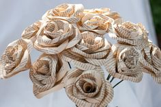 Book Page Roses! Cute idea for a centerpiece, instead of having the typical fake flowers!