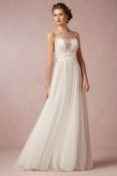 Beautiful BHLDN wedding dress: http://www.stylemepretty.com/2014/10/25/14-incredible-illusion-neckline-wedding-dresses/ #SMPLookBook