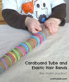 This is a super simple activity for practicing fine motor skills, using a cardboard tube and elastic hair bands.