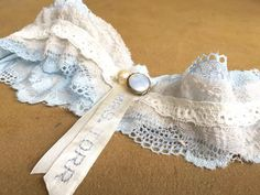 A touch of blue for Your wedding day. Vintage-inspired wedding garter. Personalised with your name.  For orders or more info: lovetheoryza@gmail.com