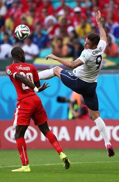 Olivier Giroud Photos Photos - Johan Djourou of Switzerland and Olivier Giroud of France compete for the ball during the 2014 FIFA World Cup Brazil Group E match between Switzerland and France at Arena Fonte Nova on June 20, 2014 in Salvador, Brazil. - Switzerland v France: Group E