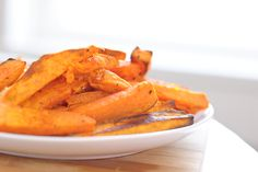 crispy, oven baked sweet potato fries! ALSO MADE THIS WAY WITH YAMs. Tossed with olive oil and sea salt,