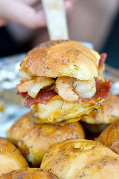 Enjoy these delicious Shrimp Bacon Sliders for easy entertaining and holiday fun! Serve them hot, or wrap in foil and bring them to the party!