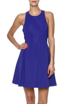 Cobalt blue fit and flare dress with a round neckline, flared skirt, back cut out design and a hidden zipper closure.    Great Escape Dress by Pink Stitch. Clothing - Dresses Miami, Florida