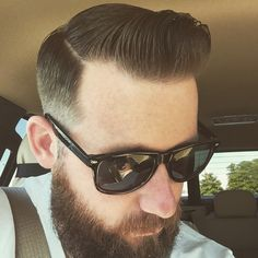 Mens hair. Hard line and side part with pomade.