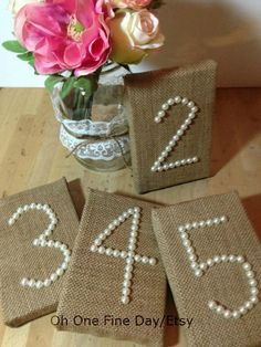 kind of LOVE these.  Pearl numbers on a burlap background.  I could totally do this.