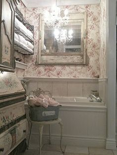 .looks like a secretary being used in this bathroom.  I love treating the bath as a true room in the house.