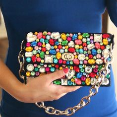 Upcycle your clutch with beads and buttons