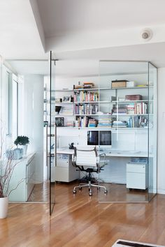 Stunning Modern Office Cubicle Decoration With Cozy Furniture: Contemporary Home Office With Glass Door White Shelves White Desk White Chair White Cabinets And Hardwood Floor