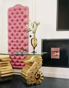 white, pink and black with gold is glamorous...can't decide what I like better, the pink padded door or the seahorse table!