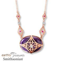 This vintage-inspired necklace from the Earthly Treasures Smithsonian™ collection features a rare, oval sugilite set in 14K rose gold. A geometric pattern accented with a round diamond embraces the sugilite, while round garnets and additional diamonds provide further contrast. The pendant has a total diamond weight of 1/15 carat and sways from a 16-inch cable chain that includes a 2-inch extender. The necklace is secured with a lobster clasp. Earthly Treasures Smithsonian™ Sugilite ...