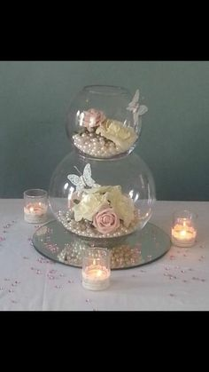 Double fish bowl centre pieces with roses and water pearls