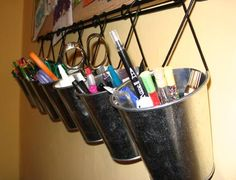 Hanging buckets for markers, colored pencils, crayons, etc.