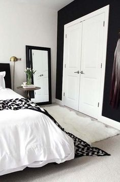 Find stylish examples of black accent walls perfect for a wall in your home that is tough to style. Domino shares photos of black accent walls to try in your home. Home Bedroom, Bedroom Makeover, Black White Bedrooms, Black Walls, Bedroom Decor, White Bedroom, Home Decor, Black Accent Walls, Remodel Bedroom